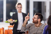 Young Couple at Restaurant with Waitress — Stock Photo