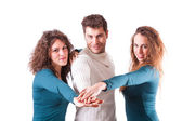 Three Happy Friends with Hands on Stack — Stock Photo