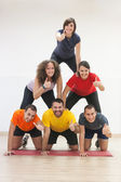 Human Pyramid and Thumbs Up — 图库照片
