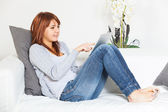 Beautiful Young Woman with Tablet PC on the Sofa — Foto de Stock