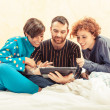 Royalty-Free Stock Photo: Friends on the Bed with Tablet PC