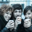 Royalty-Free Stock Photo: Group of Friends with Hot Drink on Winter