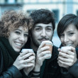 Group of Friends with Hot Drink on Winter — Stock Photo #16818429