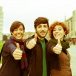 Royalty-Free Stock Photo: Happy Friends with Thumbs Up