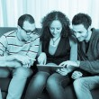 Three Friends with Tablet PC on a Sofa — Lizenzfreies Foto