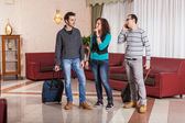 Group of with Trolley in the Hall — Stock Photo