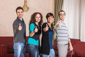 Happy Tourists with Thumbs Up — Stock Photo