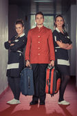 Bellboy with Two Beautiful Chambermaids — Stock Photo