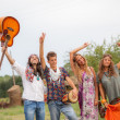 Hippie Group Playing Music and Dancing Outside — Stock Photo #17662641