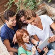 Group of Teenage Friends with Tablet PC — Stock Photo #17663615