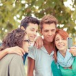 Group of Teenage Friends Taking Self Portraits with Mobile Phone — Stock Photo #17663859