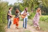 Hippie Group Playing Music and Dancing Outside — Stock Photo