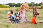 Hippie Group Playing Music and Dancing Outside — Stok fotoğraf