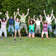 Happy Teenage College Students Jumping at Park — Stock Photo #17868309