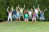 Happy Teenage College Students Jumping at Park — Stock Photo