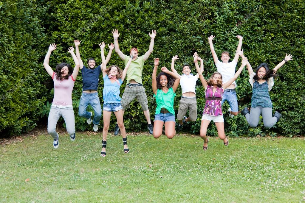Happy Teenage College Students Jumping at Park — Stock Photo ...