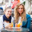 Two Girls Drinking Fruit Juice — Stock Photo