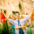 Young Couple with Shopping Bags — Stock Photo #18185957