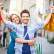 Young Couple with Shopping Bags - Stockfoto