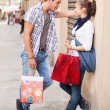 Young Couple with Shopping Bags — Stock Photo #18186119