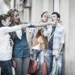 Stock Photo: Group of Friends with Shopping Bags