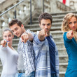 Group of Friends pointing at Camera - Stock Photo