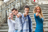 Group of Friends pointing at Camera — Стоковое фото