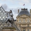 Musee du Louvre with the Pyramid — Stock Photo #18272817