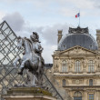 Musee du Louvre with the Pyramid - Stock Photo