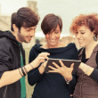 Group of Friends with Tablet PC Outside — Stock Photo