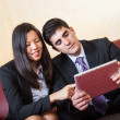 Young Business Couple on the Sofa — Stock Photo