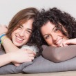 Two Beautiful Women Lying Down with Pillow — Stock Photo #18325243