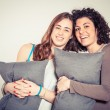 Two Beautiful Women with Pillow in the Bedroom — Stock Photo