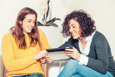 Two Beautiful Women with Digital Tablet — Foto de Stock