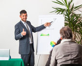 Young Businessman Explaining Plans and Charts — Stock Photo