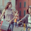 Two Beautiful Women Walking in the City with Bicycles and Bags — Stock Photo #18807515
