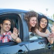 Boys and Girls in a Car Leaving for Vacation — Stock Photo #18807657