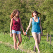 Two Beautiful Teenage Girls Walking at Park — Stockfoto