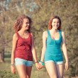 Two Beautiful Teenage Girls Walking at Park — Stock Photo