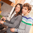 Happy Multiracial Couple in the Kitchen — Stock Photo