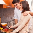 Happy Young Couple in the Kitchen — Stockfoto #18808189