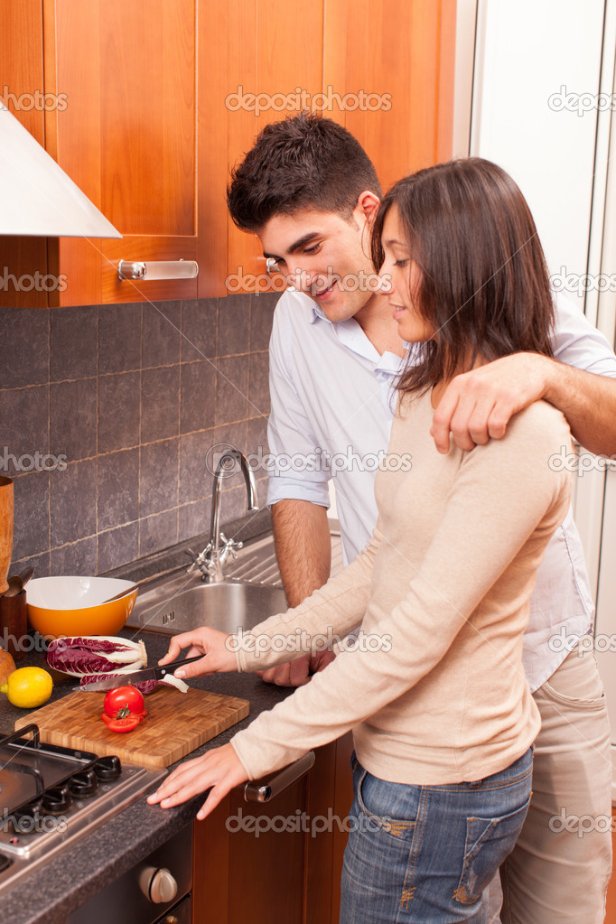 Happy Young Couple in the Kitchen — Stock Photo #18808189