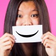 Chinese WomHolding Smiling Emoticon — Stock Photo #18957289