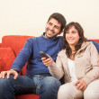 Young Couple Watching TV on the Sofa — Stock Photo #19037483