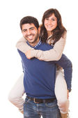 Young Man Giving a Piggyback to His Girlfriend — Stock Photo