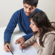 Stock Photo: Young WomStudying with Her Tutor