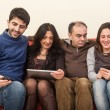 Stock Photo: Happy Family on the Sofa with Electonic Devices