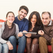 Happy Family on the Sofa with Digital Tablet — Stock Photo