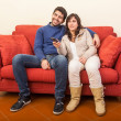 Young Couple Watching TV on the Sofa — Stok fotoğraf