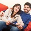 Young Couple on the Sofa with Tablet PC — Stock Photo
